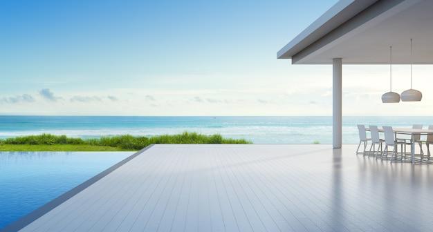Luksusowy dom na plaży z basenem z widokiem na morze i pustym tarasem w nowoczesnym stylu