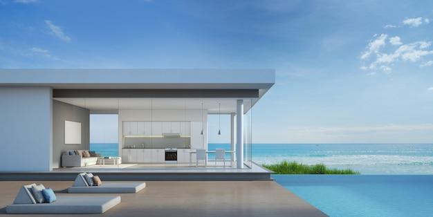 Luksusowy dom na plaży z basenem z widokiem na morze w nowoczesnym stylu.