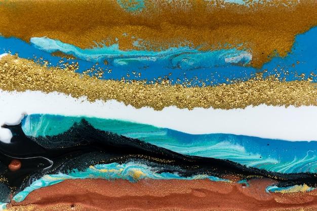 Luksusowy drogi złoty brokat i atramenty akrylowe płynne tło