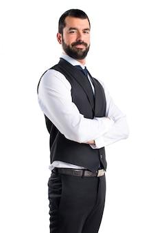 Luksusowy kelner z rękami skrzyżowanymi