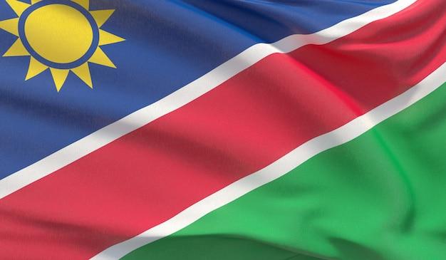 Macha flagą narodową namibii. machał bardzo szczegółowe renderowania 3d z bliska.
