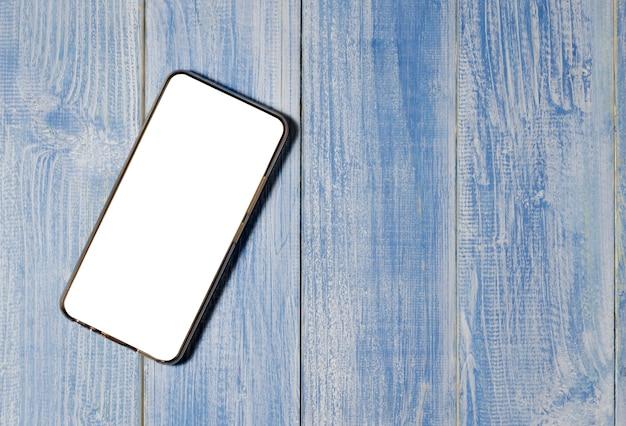 Mądrze telefon na drewnianym stołowym tle z kopii przestrzenią