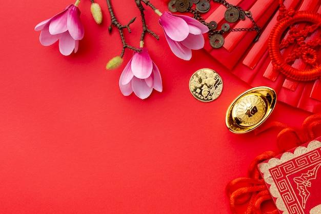 Magnolia i złota moneta chiński nowy rok
