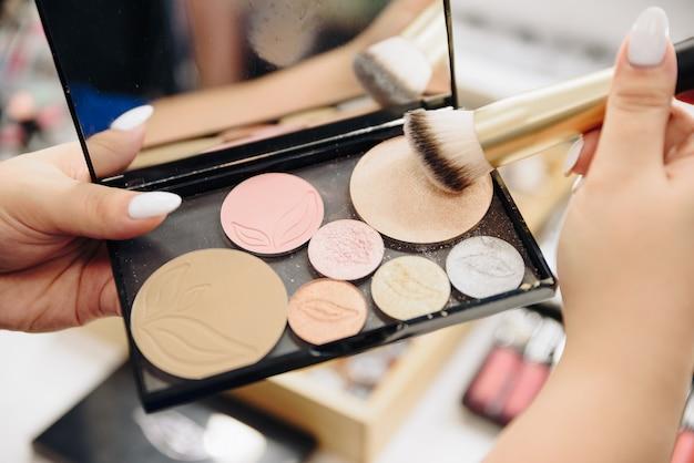 Make-up artist girl's hands with makeup