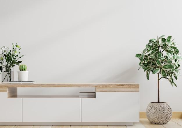 Makieta biała ściana z roślinami ozdobnymi i elementem dekoracyjnym na szafce, renderowanie 3d
