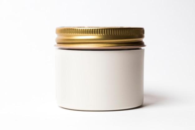 Makieta białego słoika ze złotą nasadką