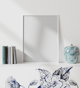 Makieta białej pustej ramki plakatowej w nowoczesnym wnętrzu w stylu orient z białą ścianą, książkami i wazonem porcelanowym, styl japoński, renderowanie 3d