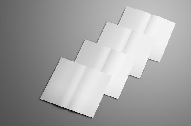 Makieta biznesowa z białymi czterema broszurami a4 a5 bifold na szarym tle