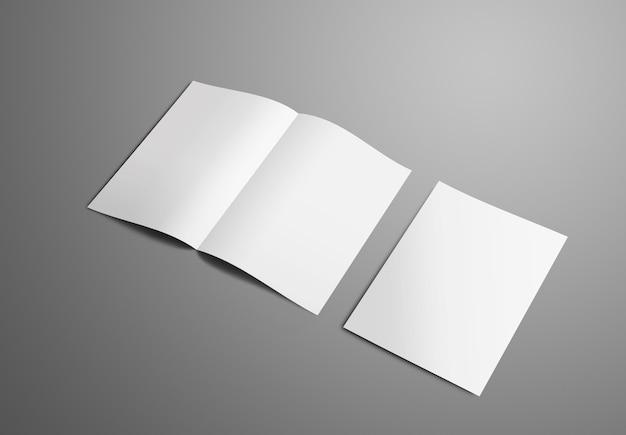 Makieta biznesowa z dwiema broszurami bifold a4 a5 z realistycznymi cieniami na białym tle