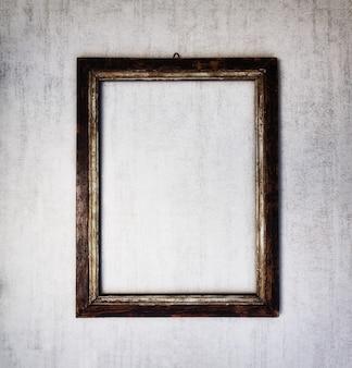 Makieta do starej drewnianej ramy na szarym tle grunge. przyciemniony obraz