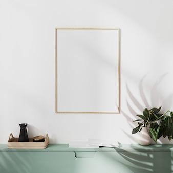 Makieta drewniana ramka plakatowa na białej ścianie z cieniem palmowym i zielonymi szafkami z dekoracją, ilustracja 3d