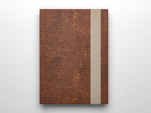 Makieta fotorealistycznego pamiętnika ze skóry na białym tle na jasnoszarej powierzchni, renderowanie 3d