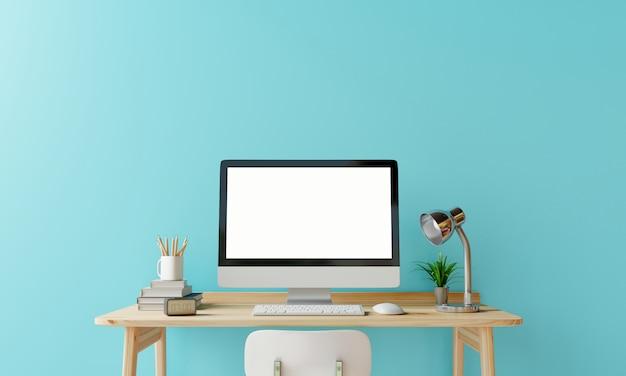 Makieta komputera do pracy z pustym ekranem na drewnianym stole w niebieskim pokoju pastelowym.