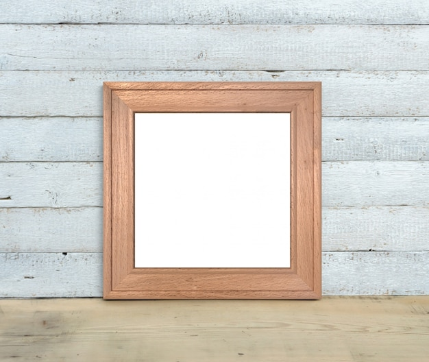 Makieta kwadratowej drewnianej ramy stoi na drewnianym stole