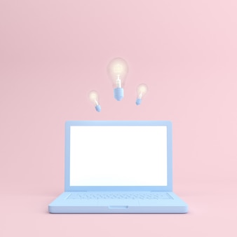 Makieta laptopa z pustym ekranem i żarówką.
