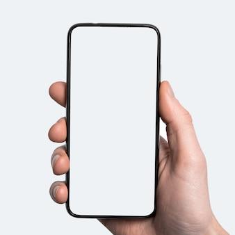 Makieta, makieta mężczyzna ręka trzymająca czarny smartfon z ramką mniej pustym ekranem