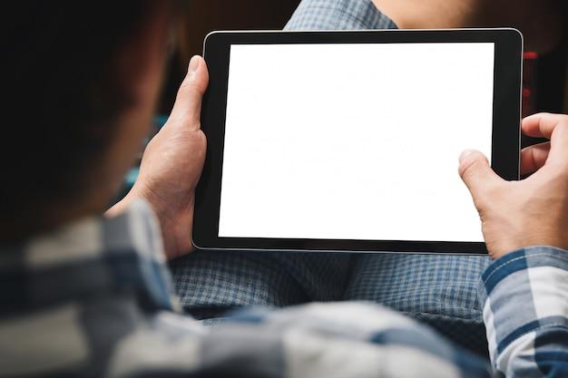 Makieta obrazu tabletu, człowiek przy użyciu komputera typu tablet