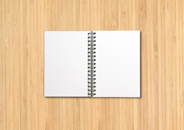 Makieta pusty notatnik otwarta spirala na białym tle na drewno