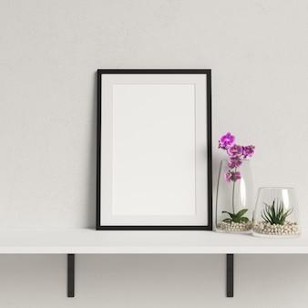 Makieta ramki na białej półce z minimalistycznym dekoracje roślin