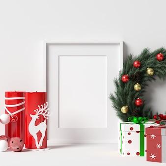 Makieta ramki na białej ścianie z bożego narodzenia ozdoba