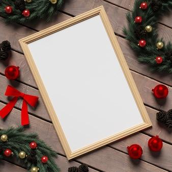 Makieta ramki na drewnianej podłodze z świątecznych dekoracji