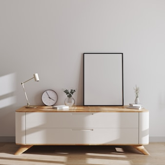 Makieta ramki plakatowej w nowoczesnym wnętrzu w stylu skandynawskim na minimalistycznej komodzie z wystrojem. makieta ramki plakatu lub obrazu, renderowania 3d