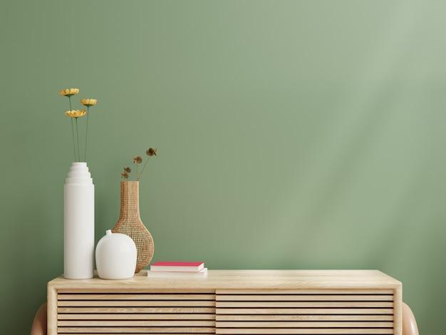 Makieta ściany wewnętrznej, zielona ściana i drewniana szafka. renderowanie 3d