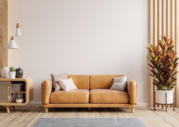 Makieta ścienna wewnętrznego salonu ze skórzaną sofą i wystrojem na białym tle. renderowanie 3d