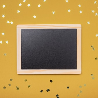 Makieta tablicy na boże narodzenie ze złotymi gwiazdami