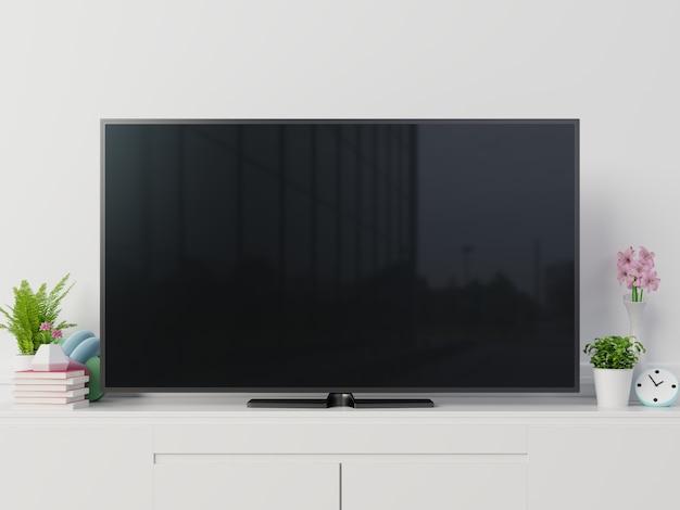 Makieta telewizyjna z pustym czarnym ekranem na szafce. renderowania 3d