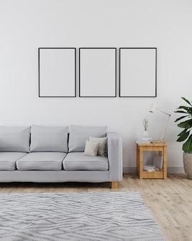 Makieta trzech ramek plakatowych w nowoczesnym i minimalistycznym wnętrzu salonu z szarą sofą i białą ścianą