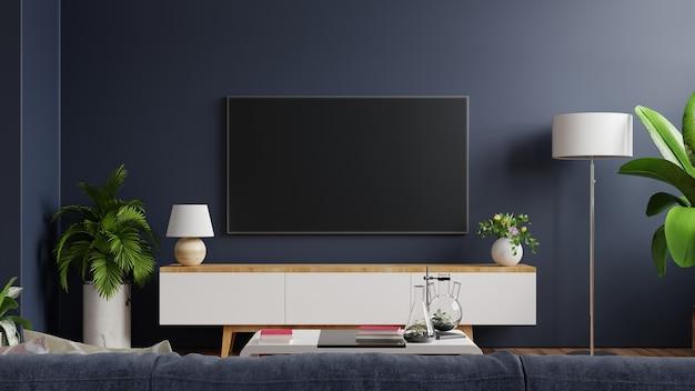 Makieta tv na szafce w nowoczesnym pustym pokoju z ciemnoniebieską ścianą. renderowanie 3d