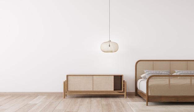 Makieta wnętrza jasnej sypialni, drewniane łóżko z rattanu na pustej białej ścianie