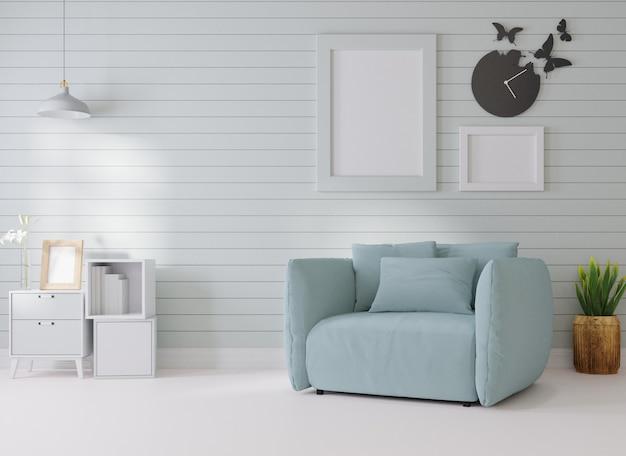 Makieta wnętrza w białym pokoju obok ramki na zdjęcia na ścianie stoi niebieska sofa