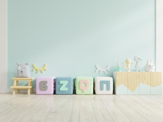 Makiety ściany w pokoju dziecięcym na niebieskim tle ściany.