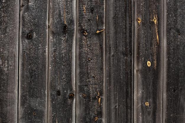 Makro duża drewniana brama i suszone drewno. tekstura drewna deski