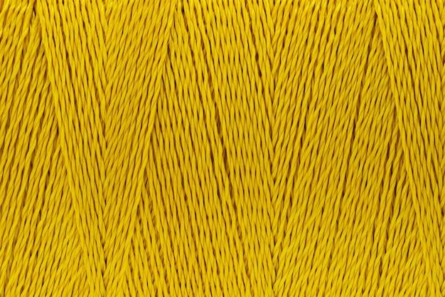 Makro- obrazek nici tekstury koloru złocisty tło