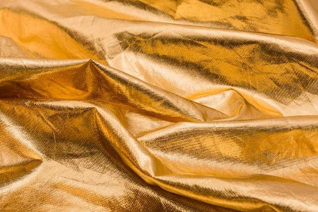Makro pomarszczony złoty materiał