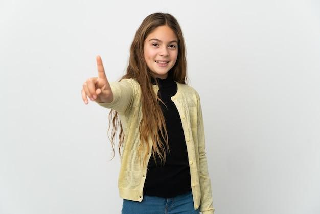 Mała dziewczynka na białym tle pokazując i podnosząc palec
