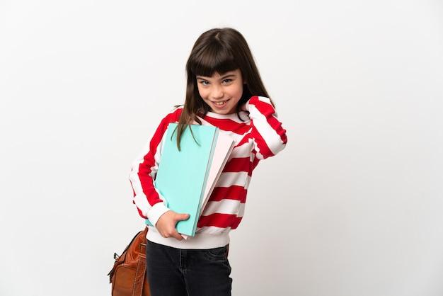 Mała studencka dziewczyna na białym tle śmiejąc się