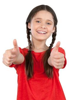 Mała studentka pokazując kciuk do góry na białym tle