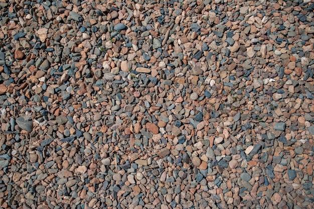 Małe kamienie na tle. tekstura. grys