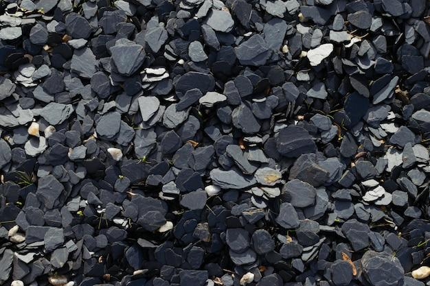 Małe kamienie tło łupków