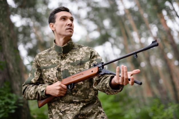 Male shooter recharging shotgun gamebird hunt.