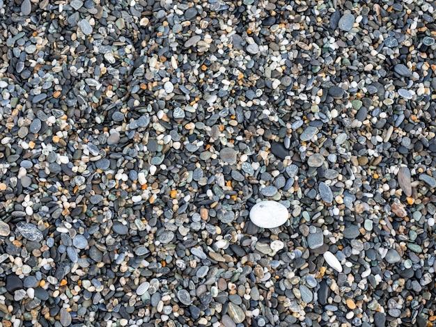 Małe skały teksturowane tło. tekstura żwiru. pokruszona tekstura granitu