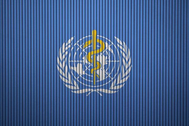 Malowana flaga who na betonowej ścianie