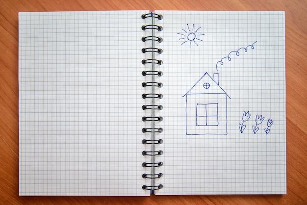 Malowany dom w notatniku