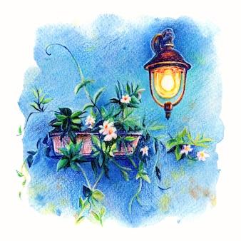 Malownicza latarnia i kwiaty na niebieskiej ścianie domu na słynnej wyspie burano, wenecja, włochy
