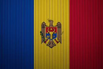 Malująca flaga państowowa Moldova na betonowej ścianie