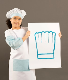 Mały afroamerican szefa kuchni gospodarstwa transparent